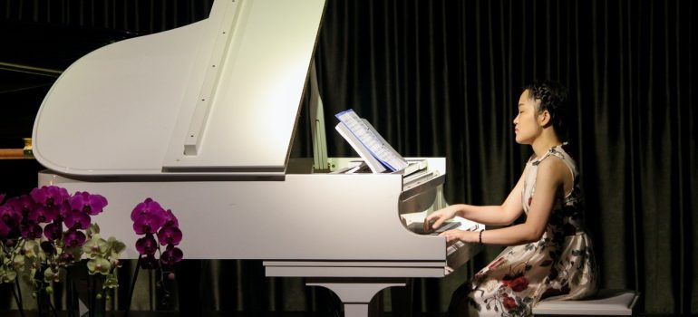 a girl playing a piano