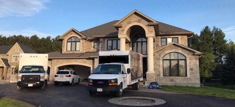 a moving truck in front of a home