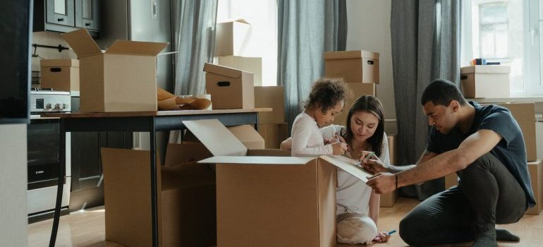 family around moving boxes in their new home