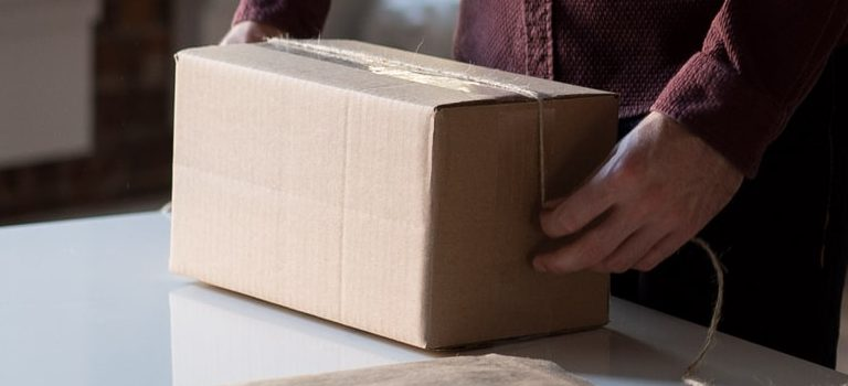 A man packing cardboard box for moving