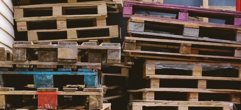 Use wooden pallets to pest-proof a storage unit