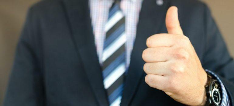 man pointing his thumb up