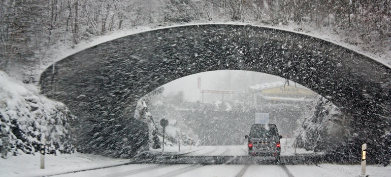 vehicle going through the snow