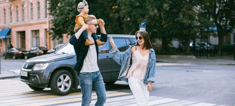 couple walking with a child
