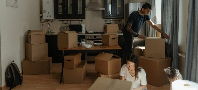 man and woman packing