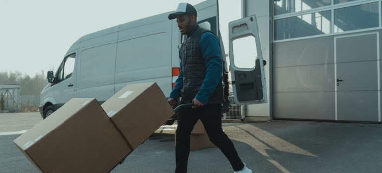 a professional mover using dolly to prevent moving day injuries