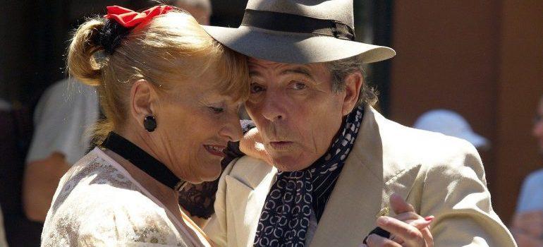 Two senior citizens dancing.