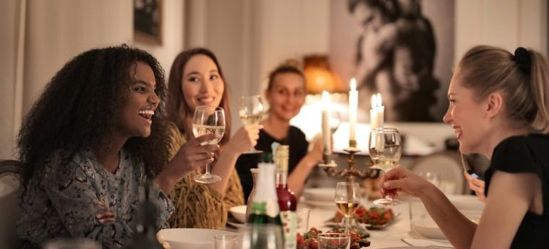 Smiling women at the table.