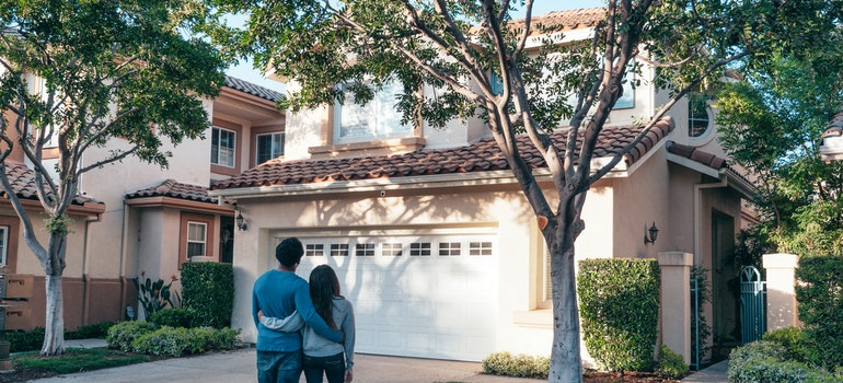 couple looking into a house