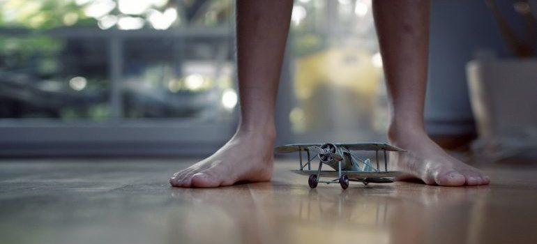 barefoot with a toy airplane is not good for moving bulky furniture