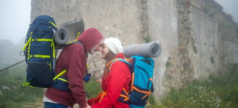 elderly couple hiking in the rain