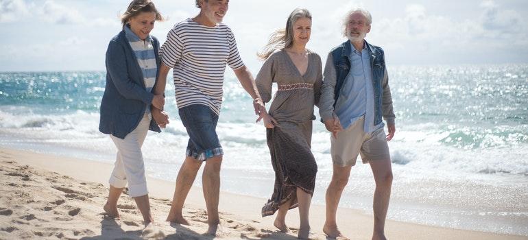 elder people walking on the beach
