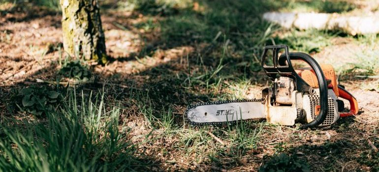A chainsaw on the ground