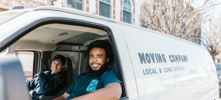 two men in a moving van